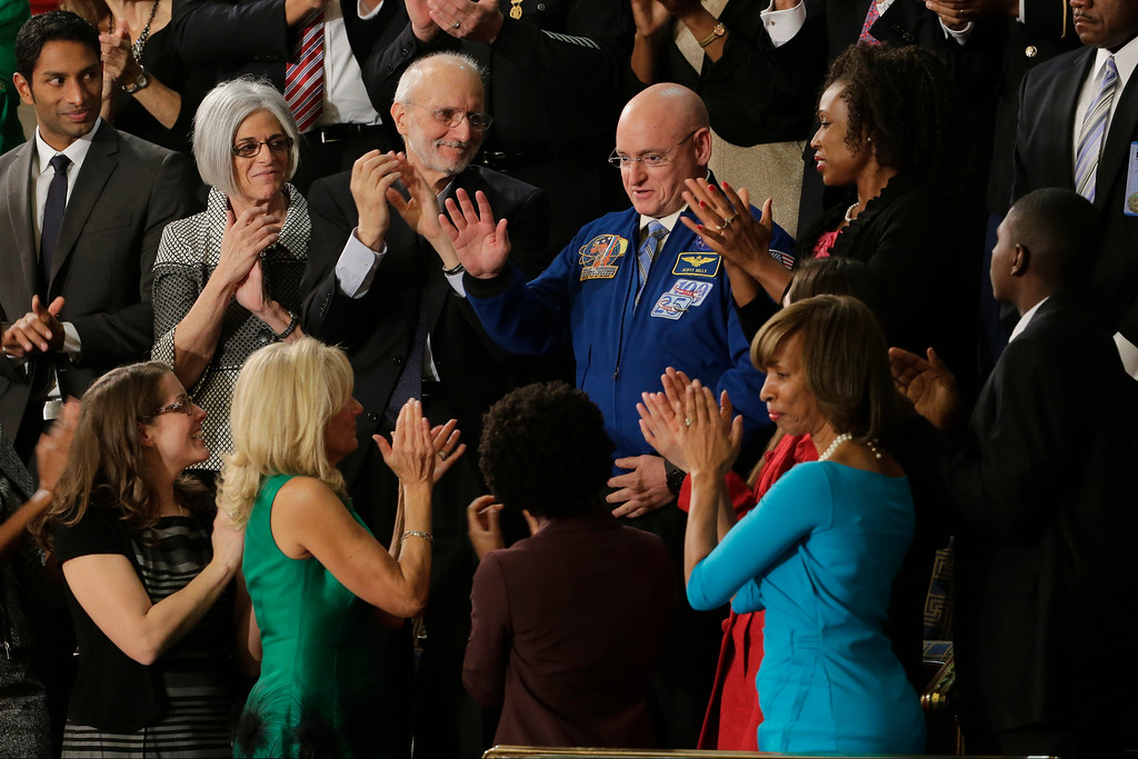 . Astronaut Scott Kelly is applauded on  Capitol Hill in Washington, Tuesday, Jan. 20, 2015, during Presient Barack Obama\'s State of the Union address before a joint session of Congress on Capitol Hill in Washington, Tuesday, Jan. 20, 2015. Front row, from left are, Rebekah Erlerm Jill Biden, Chelsey Davis and Ana Zamora. Second row, from left are, Pranav Shetty, Judy Gross, Alan Gross Kelly and Katrice Mubiru.  (AP Photo/J. Scott Applewhite)
