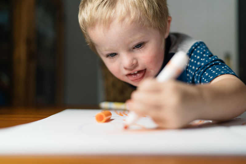 Little Boy Happily Drawing