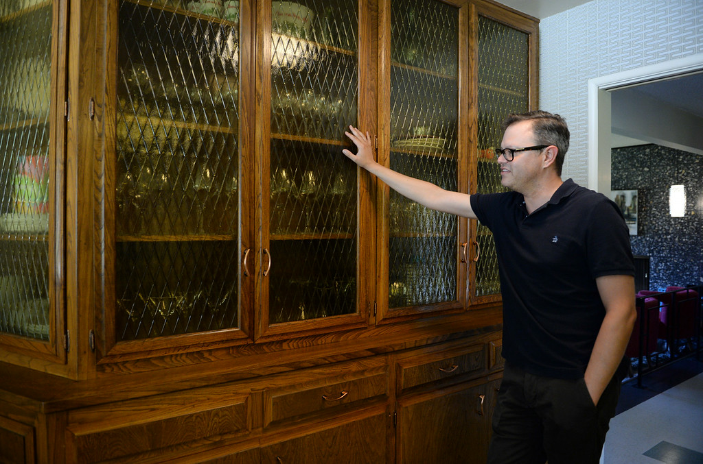 . Redlands resident Nathan Gonzales points out the glass cabinetry in his kitchen on Thursday, July 10, 2014 in Redlands, Ca. Gonzales\' home was added to the city�s historic register list and is the second post-World War II era building added to it. (Photo by Micah Escamilla/Redlands Daily Facts)