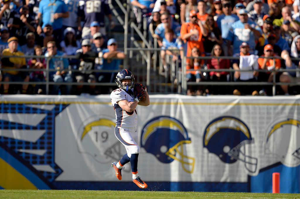 . SAN DIEGO, CA. December 14, - wide receiver Wes Welker #83 of the Denver Broncos catches a punt in the first half vs the San Diego Chargers at Qualcomm Stadium December 14, 2014 San Diego, CA (Photo By Joe Amon/The Denver Post)