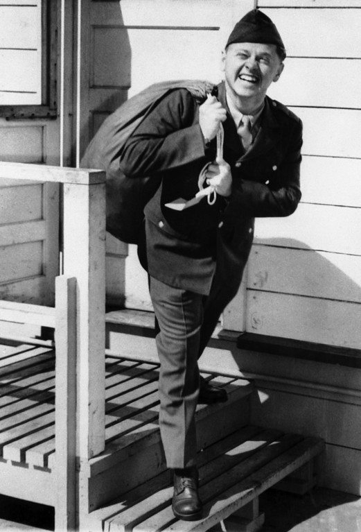 . Flashing the same smile known to millions of film-goers, Mickey Rooney, 22, year-old film star, steps from the induction station at Fort MacArthur, Los Angeles, California, on June 26, 1944, wearing an army uniform and carrying a duffel bag over his shoulder. ? (AP Photo)