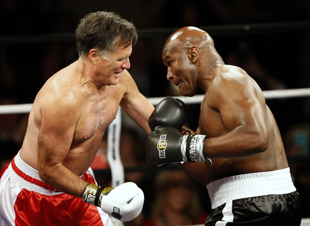 ". Mitt Romney, (L) Evander Holyfield (R), fight  in a charity boxing event on May 15, 2015 in Salt Lake City, Utah. The event was held to raise money for  ""Charity Vision\"" a charity that aims to restore sight to the blind and visually impaired. (Photo by George Frey/Getty Images)"