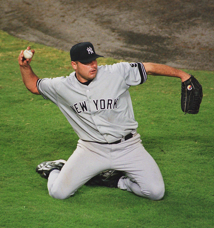 . ROGER CLEMENS -- New York Yankees pitcher Roger Clemens picks up Texas Rangers\' Tom Goodwin\'s grounder in the fifth inning on Oct. 9, 1999 in Arlington, Texas, during game three of the American League division series.  (AP Photo/Tim Sharp)