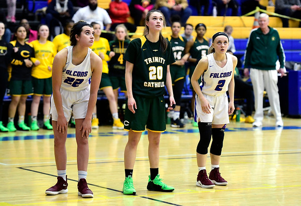 3/8/2019 Mike Orazzi | Staff St. Paul Catholic High School's Morgan Kolb (22) and Kailyn Bielecki (2) with Trinity Catholic's Kiera Fenske (20) during the Class S Semifinal girls basketball game at Newtown High School Friday night in Newtown.