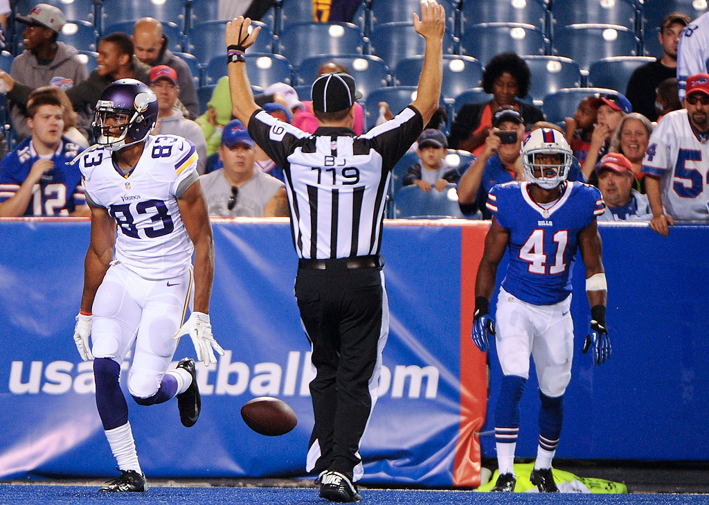 . Minnesota Vikings\' Rodney Smith (83) celebrates after catching a pass for a touchdown as Buffalo Bills\' Jumal Rolle (41) looks on during the second half of an NFL preseason football game Friday, Aug. 16, 2013, in Orchard Park, N.Y.  (AP Photo/Gary Wiepert)