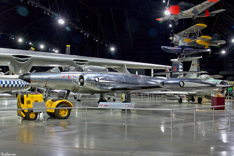 National Museum of the United States Air Force, Dayton, Ohio,   04/13/2019  Avro Canada CF-100 CanuckMk4A c/n 141       18241 (RCAF) Painted  as a Mk.4A of 428 Squadron of the mid-1950s Hanging behind is Grumman J2F-6 Duck c/n 33587 painted as OA-12 8563 This work is licensed under a Creative Commons Attribution- NonCommercial 4.0 International License.