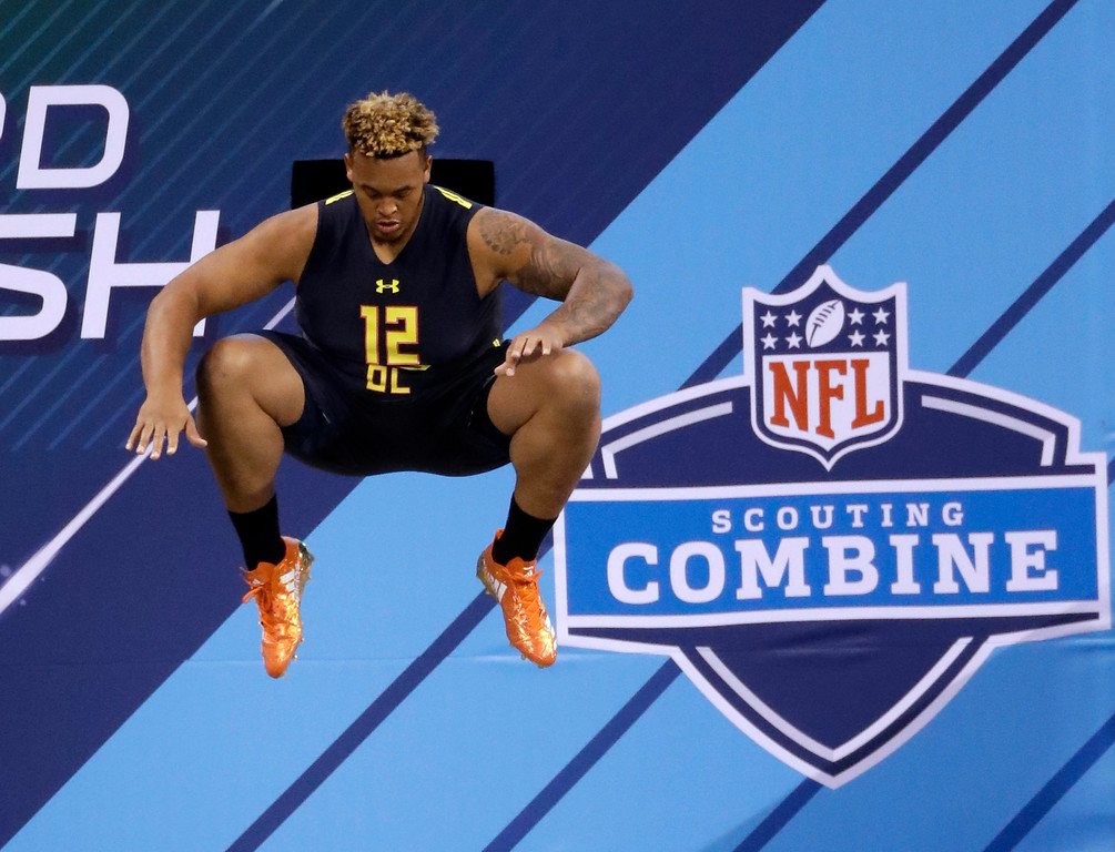 . Temple offensive lineman Dion Dawkins prepares to run the 40-yard dash at the NFL football scouting combine Friday, March 3, 2017, in Indianapolis. (AP Photo/David J. Phillip)