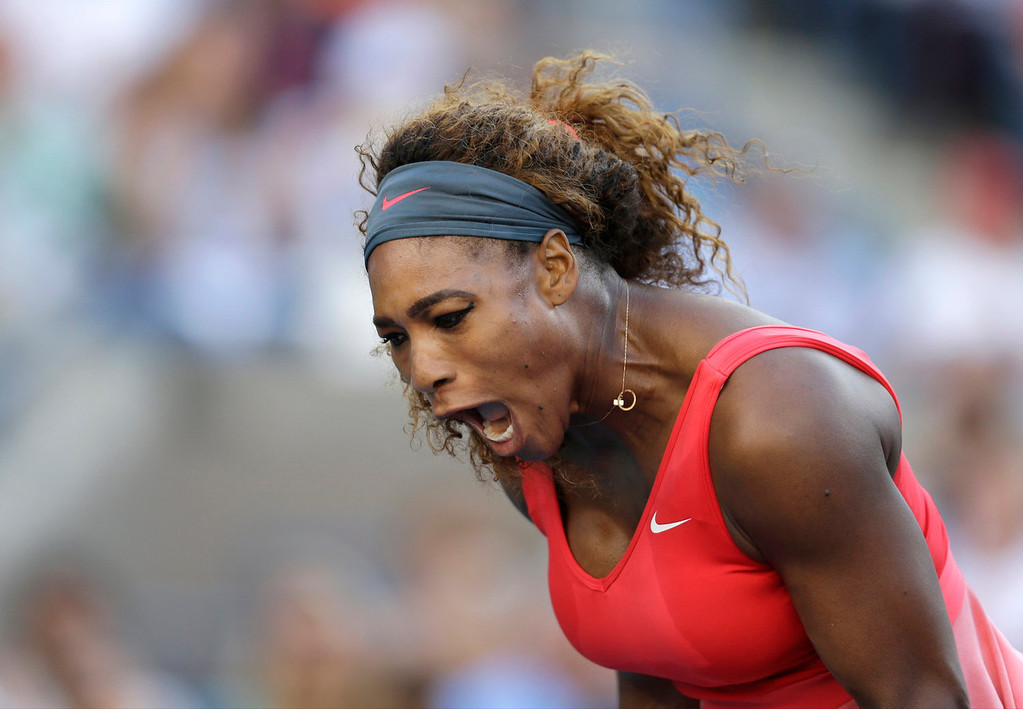 . Serena Williams reacts after a point against Victoria Azarenka, of Belarus, during the women\'s singles final of the 2013 U.S. Open tennis tournament, Sunday, Sept. 8, 2013, in New York. (AP Photo/Darron Cummings)