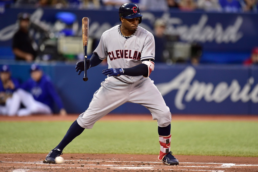 . Cleveland Indians\' Rajai Davis drops his bat after being walked by the Toronto Blue Jays during the third inning of a baseball game Friday, Sept. 7, 2018, in Toronto. (Frank Gunn/The Canadian Press via AP)
