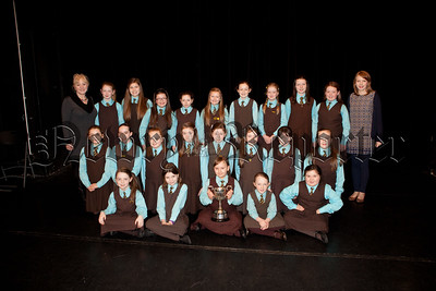 Pictured are pupils from St Clares PS who won the Mary Murphy cup for Fireside Singing. Also pictured is Elanyna Duffy Arts Co-Ordinator and Adele Griffin Pianist. R1510008