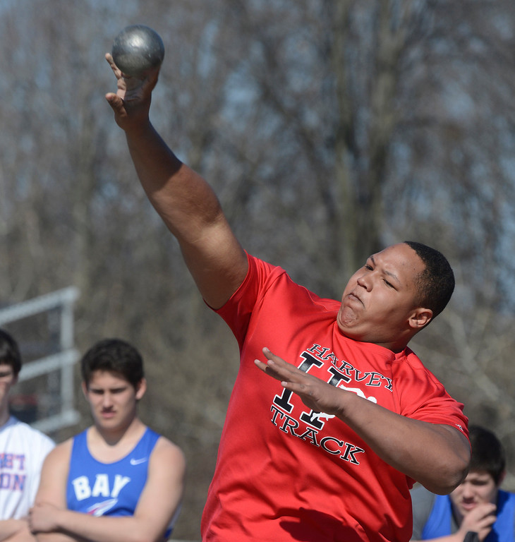 """. Maribeth Joeright/MJoeright@News-Herald.com<p> Harvey\'s Reggie Browley throws in the shot put event during the Hilltopper Invitational track meet at Chardon High School, April 12, 2014. Browley won the event with a throw of 52\'6\""""."""