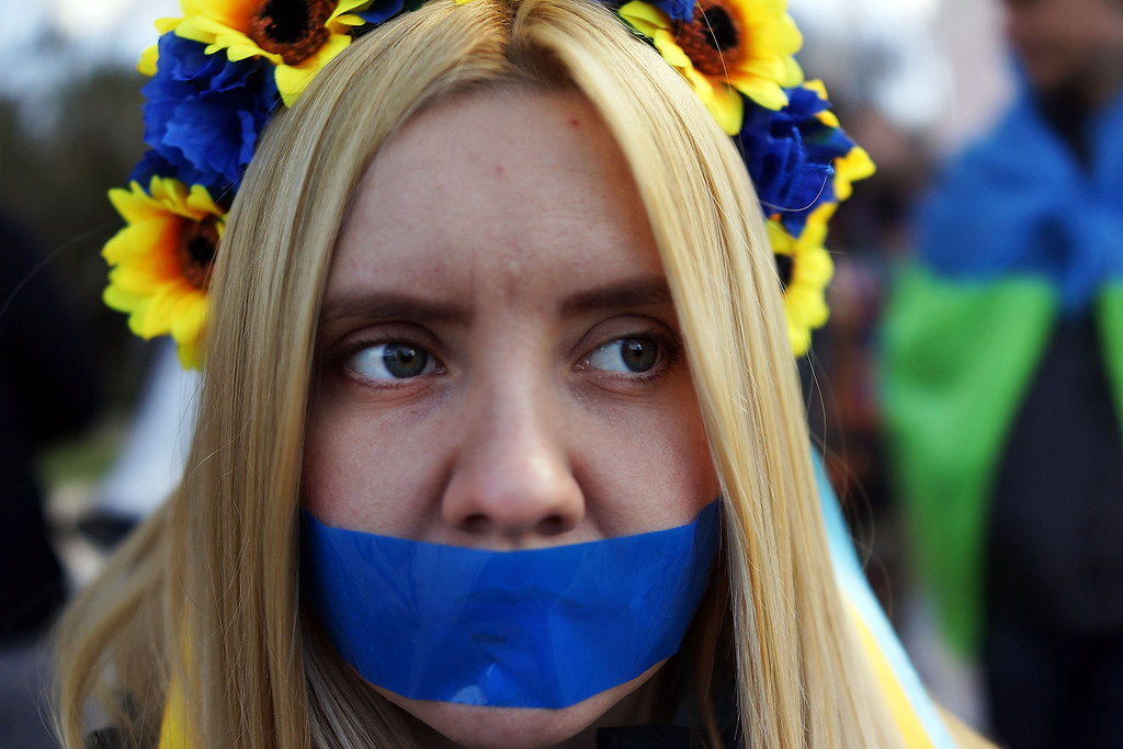 . A supporter of Ukraine, with their mouth taped over, attends a rally in support of the Keeping Crimea a part of the Ukraine on March 13, 2014 in Simferopol, Ukraine. As the standoff between the Russian military and Ukrainian forces continues in Ukraine\'s Crimean peninsula, world leaders are pushing for a diplomatic solution to the escalating situation. Crimean citizens will vote in a referendum on 16 March on whether to become part of the Russian federation. (Photo by Spencer Platt/Getty Images)