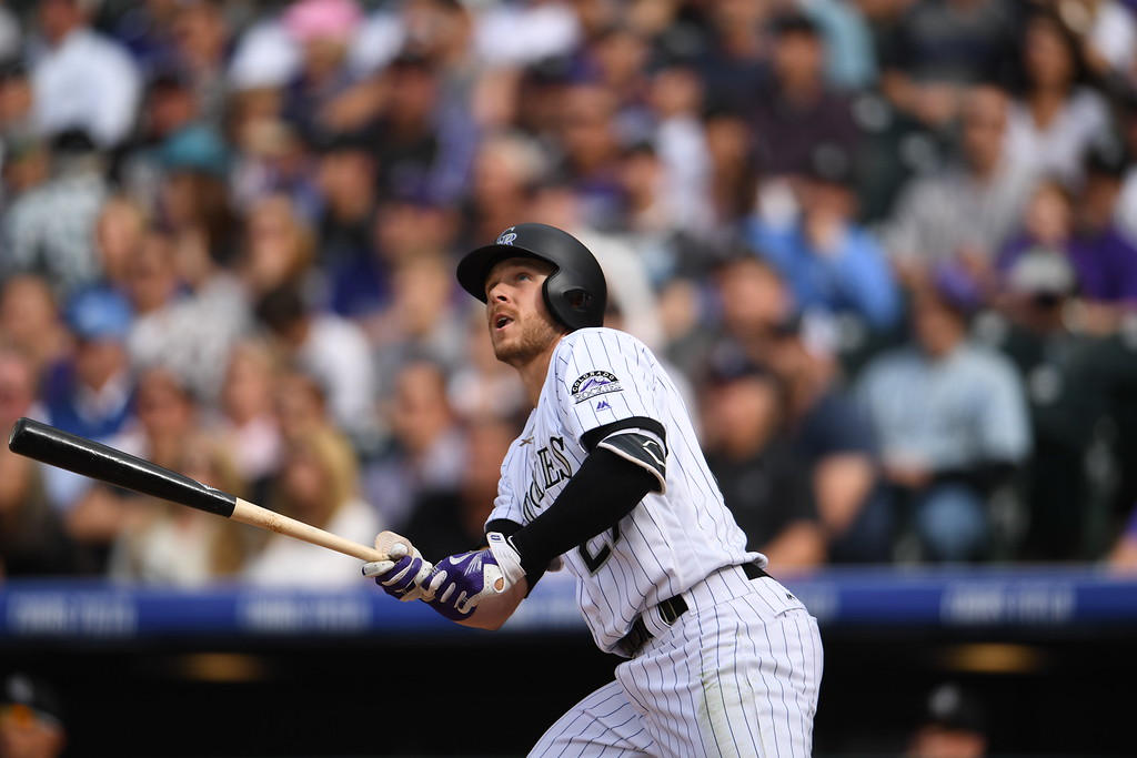. Trevor Story (27) of the Colorado Rockies hits a home run during the fourth inning, batting in a run for Charlie Blackmon (19). The Colorado Rockies played the San Diego Padres Friday, April 8, 2016 on opening day at Coors Field in Denver, Colorado. (Photo By RJ Sangosti/The Denver Post)