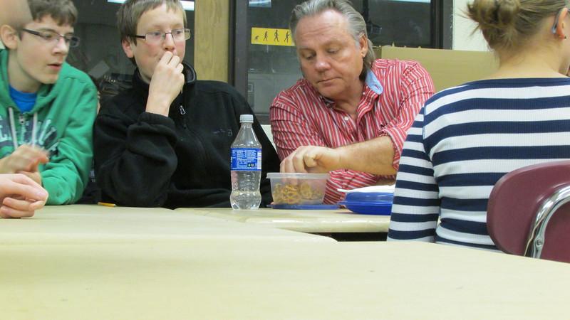 Mr. S. returns and it looks like he's enjoying Tim's pretzels.