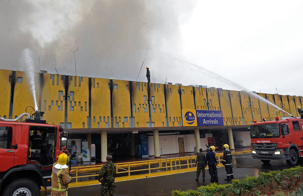 . Firefighters try to control a blaze outside the burning Jomo Kenyatta International airport in Nairobi on August 7, 2013.  AFP PHOTO/StringerSTRINGER/AFP/Getty Images