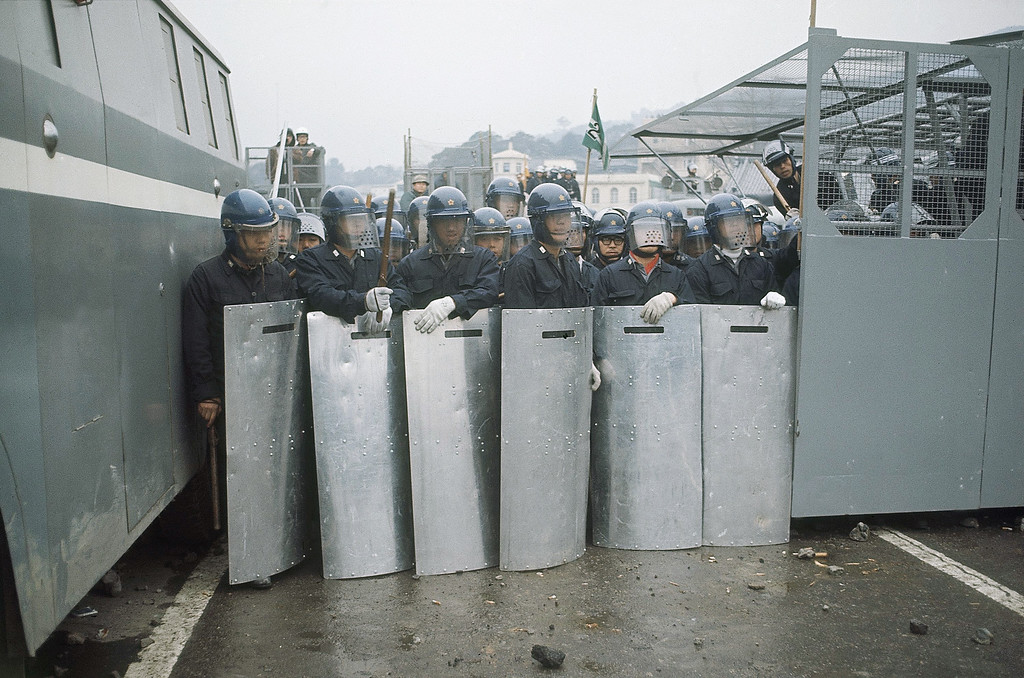 . Riot police at Sasebo Streets, Japan on Jan. 20, 1968. Demonstrators, including the Sampo Rengo elements of the Zengakuren student group started a �Quiet� demonstration at Sasebo Streets. (AP Photo)