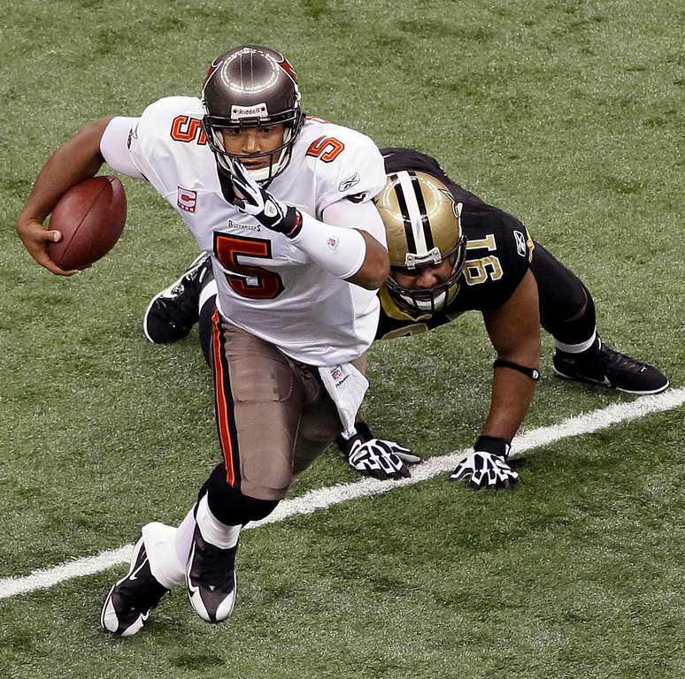 . Josh Freeman, Kansas State Selected 17th overall by the Buccaneers in 2009 Freeman�s brief NFL career has been marked by peaks and valleys. In the 2009 and �11 seasons, Freeman combined for 26 touchdowns and 40 interceptions, and the Bucs went a combined 7-17. In 2010 and �12, Freeman was among the better quarterbacks in the NFL, passing for 52 touchdowns and just 23 interceptions. In those two seasons, Tampa Bay went 17-15. GRADE: B-. With a little more consistency, his grade should climb. (AP Photo/Patrick Semansky)