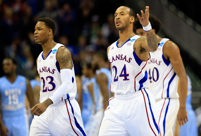 . (L-R) Ben McLemore #23 and Travis Releford #24 of the Kansas Jayhawks walk on the court in the first half against the North Carolina Tar Heels during the third round of the 2013 NCAA Men\'s Basketball Tournament at Sprint Center on March 24, 2013 in Kansas City, Missouri.  (Photo by Jamie Squire/Getty Images)