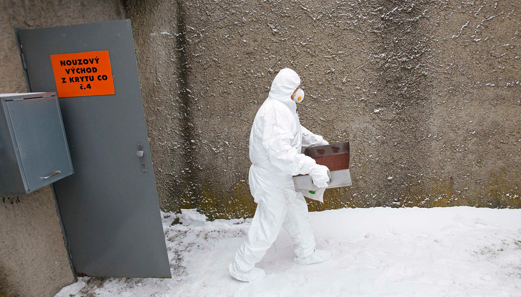 . A worker wearing a protective suit and a mask exits a fallout shelter during a nuclear accident simulation as part of a safety regulations exercise at Nuclear Power Plant Dukovany in Dukovany March 26, 2013.     REUTERS/David W Cerny