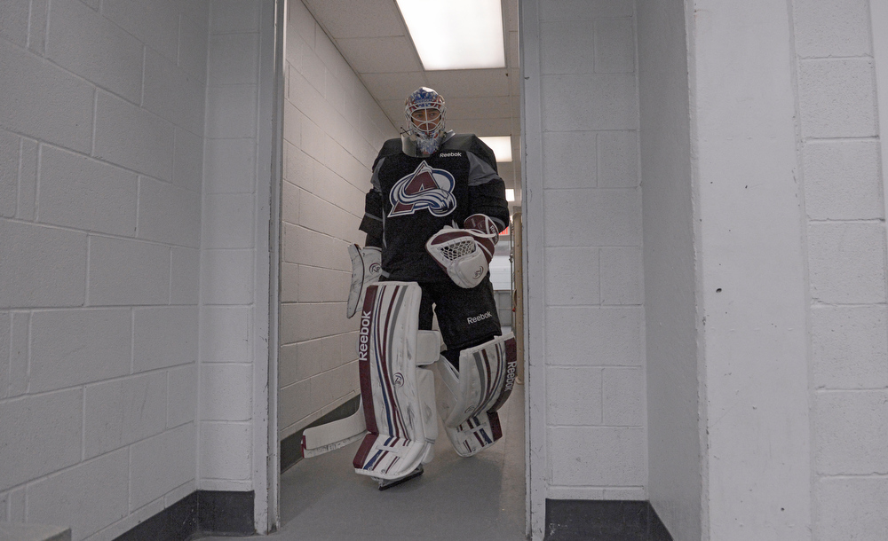 . Colorado Avalanche G J.S. Giguere (35) heads to the ice for practice Wednesday, January 16, 2013 at Family Sports Center. John Leyba, The Denver Post