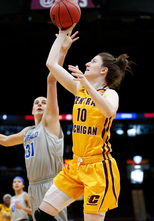 . Central Michigan guard Cassie Breen shoots against Buffalo center Cassie Oursler during the second half of an NCAA college basketball game in the championship of the Mid-American Conference tournament Saturday, March 10, 2018, in Cleveland. Central Michigan won 96-91. (AP Photo/Ron Schwane)