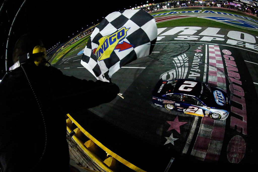 . CONCORD, NC - OCTOBER 12:  (HANDOUT PHOTO, NO ARCHIVE, NO SALES, ONE TIME EDITORIAL USE ONLY.)  Brad Keselowski, driver of the #2 Miller Lite Ford, takes the checkered flag as he crosses the finish line to win the NASCAR Sprint Cup Series Bank of America 500 at Charlotte Motor Speedway on October 12, 2013 in Concord, North Carolina.  (Photo by Chris Graythen/NASCAR via Getty Images)
