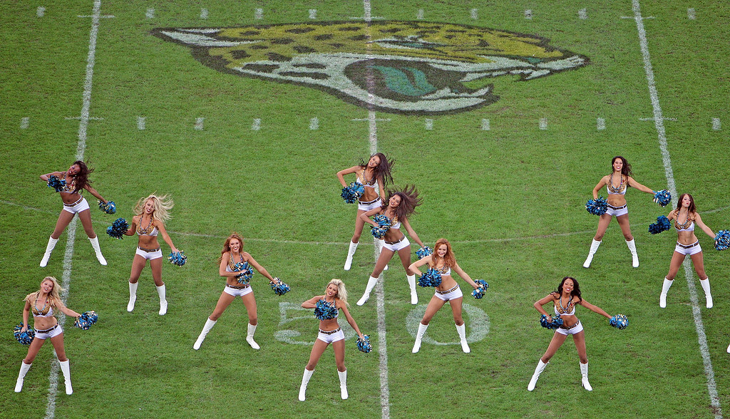 . Jaguars cheerleaders entertain the crowd ahead of the NFL football game between San Francisco 49ers and Jacksonville Jaguars at Wembley Stadium in London, Sunday, Oct. 27, 2013. (AP Photo/Nicky Hayes, NFL UK)