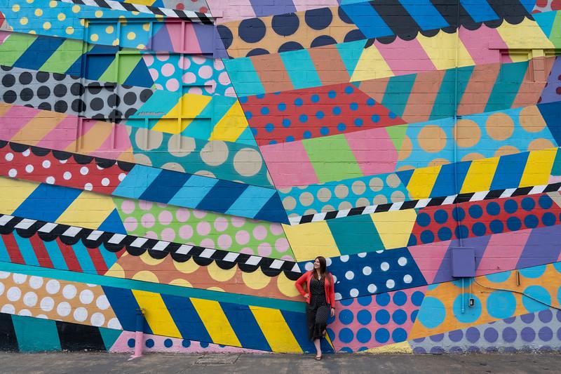 Amanda and a mural in The Gulch, Nashville
