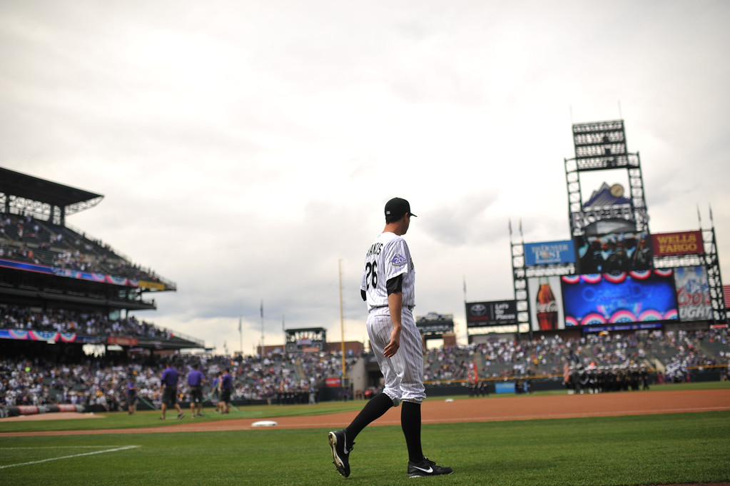 . Jeff Francis (26) of the Colorado Rockies takes the field to warm up before the start of the game.  (Photo by Hyoung Chang/The Denver Post)
