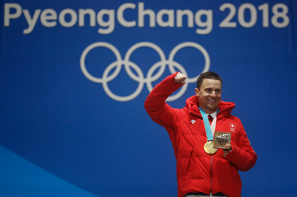 . Gold medalist in the men\'s parallel giant slalom Nevin Galmarini, of Switzerland, celebrates during the medals ceremony at the 2018 Winter Olympics in Pyeongchang, South Korea, Saturday, Feb. 24, 2018. (AP Photo/Patrick Semansky)