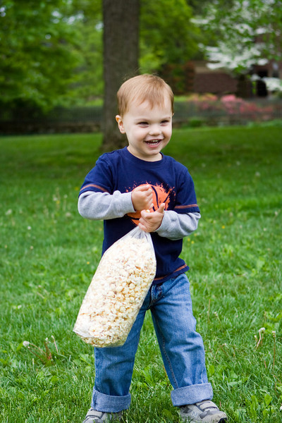K.C. is on the move, popcorn snack in hand.