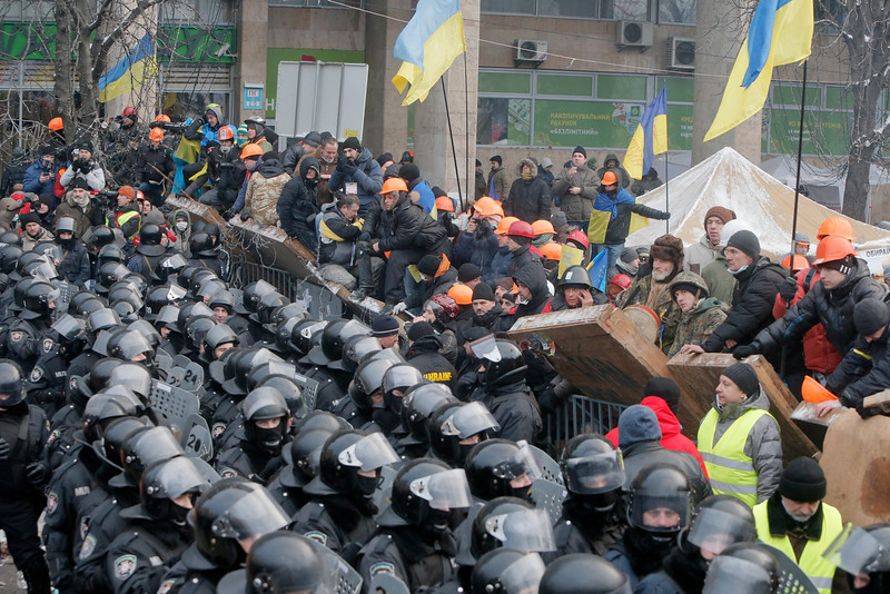 . Pro-European Union activists guard the barricade during clashes with riot police in Independence Square in Kiev, Ukraine, Wednesday, Dec. 11, 2013. Security forces clashed with protesters as they began tearing down opposition barricades and tents set up in the center of the Ukrainian capital early Wednesday, in an escalation of the weeks-long standoff threatening the leadership of President Viktor Yanukovych.  (AP Photo/Efrem Lukatsky)