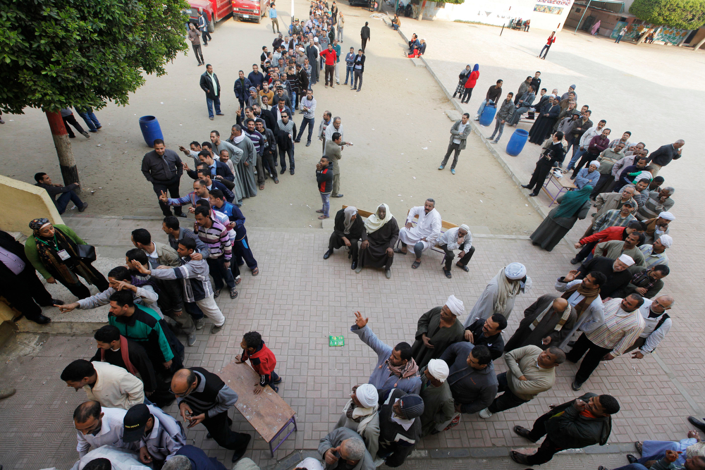 . Egyptian voters line up outside a polling station in Cairo, Egypt, Tuesday, Jan. 14, 2014. Egyptians have started voting on a draft for their country\'s new constitution that represents a key milestone in a military-backed roadmap put in place after President Mohammed Morsi was overthrown in a popularly backed coup last July. (AP Photo/Amr Nabil)