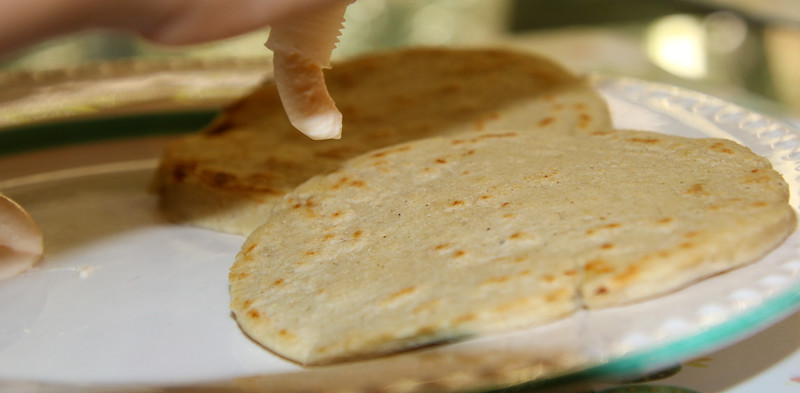Two tortillas flat on a dish