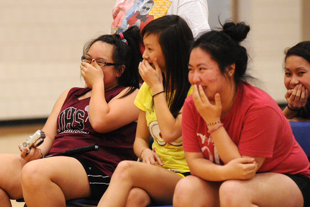 . Players and fans of the Johnson Senior High School badminton team laugh at one of their players during a doubles match against Harding. (Pioneer Press: John Autey)