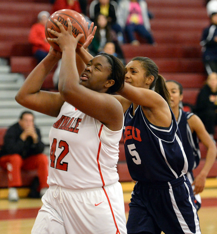 . Lawndale\'s Taylor Buffin (42) takes the ball to the basket against Leuzinger\'s Tajaheray McMahan (5) in a girls basketball game at Lawndale High Tuesday, December 10, 2013, in Lawndale, CA.  Photo by Steve McCrank/DailyBreeze