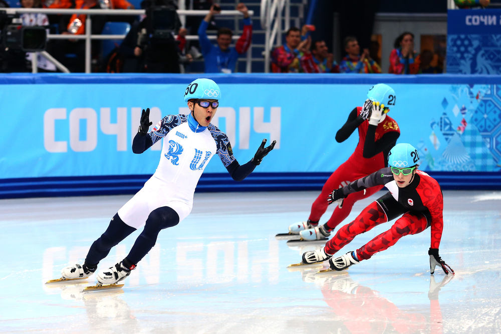 . Victor An (L) of Russia celebrates winning the gold medal in the Short Track Men\'s 500m Final A on day fourteen of the 2014 Sochi Winter Olympics at Iceberg Skating Palace on February 21, 2014 in Sochi, Russia.  (Photo by Ryan Pierse/Getty Images)