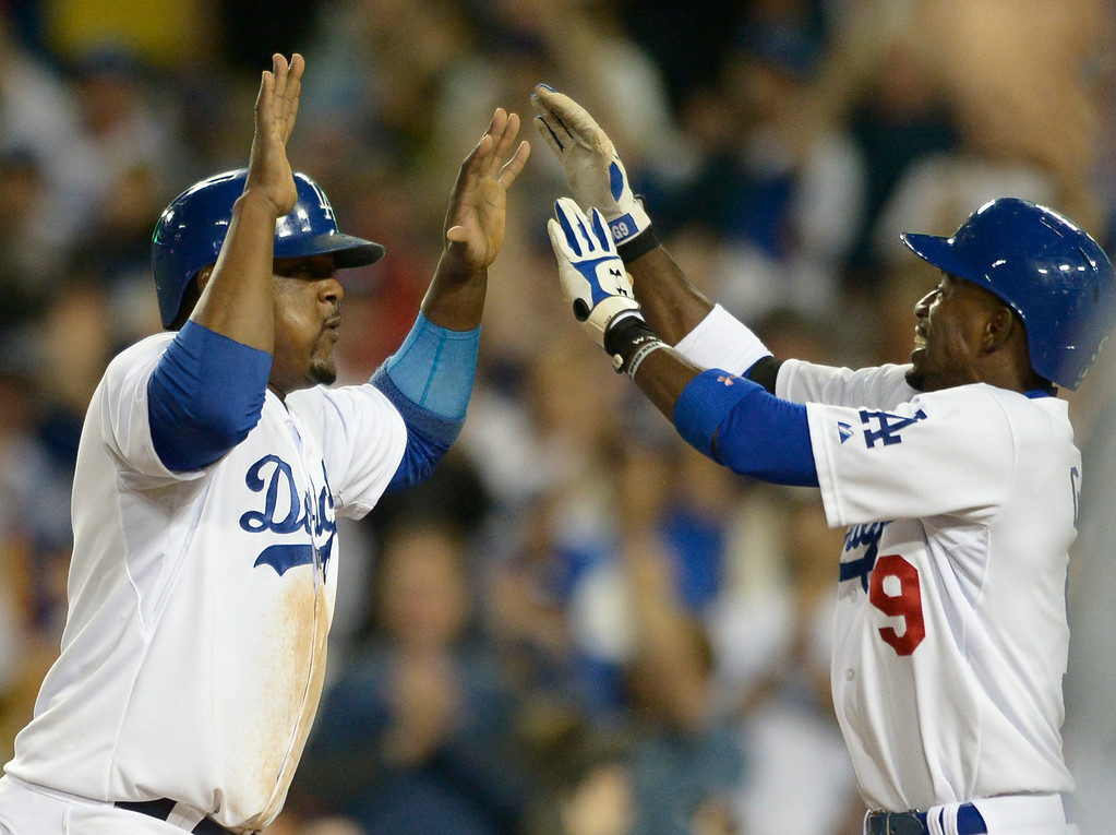 . Juan Uribe celebrates after reaching home on a walk off single by Andre Ethier in the 9th inning. The Dodgers defeated the Angels 5-4. Los Angeles, CA. 8/5/2014(Photo by John McCoy Daily News)