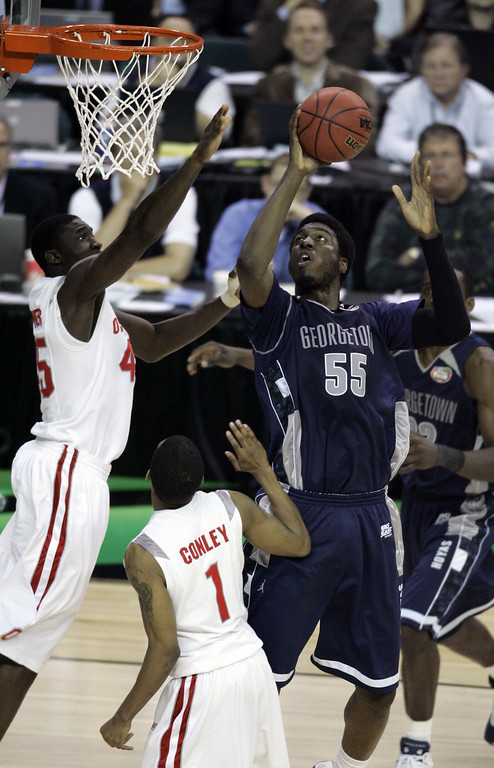 . Georgetown\'s Roy Hibbert (55) attempts a basket as Othello Hunter, left, and Mike Conley, bottom, block during their Final Four semifinal basketball game at the Georgia Dome in Atlanta, Saturday, March 31, 2007. (AP Photo/Charlie Neibergall)