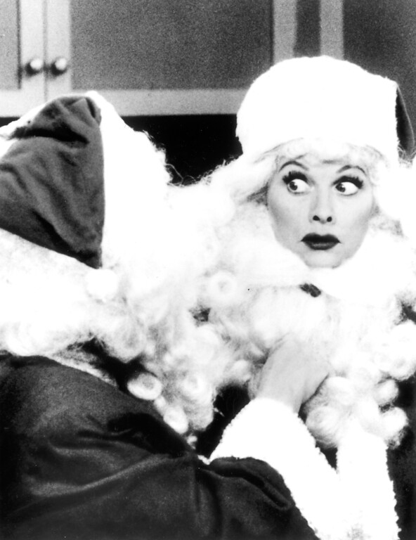 ". Lucy Ricardo takes on the role of the family\'s Santa, then encounters a stranger in a red suit, in the ""I Love Lucy Christmas Special\""   Los Angeles Daily News file photo"