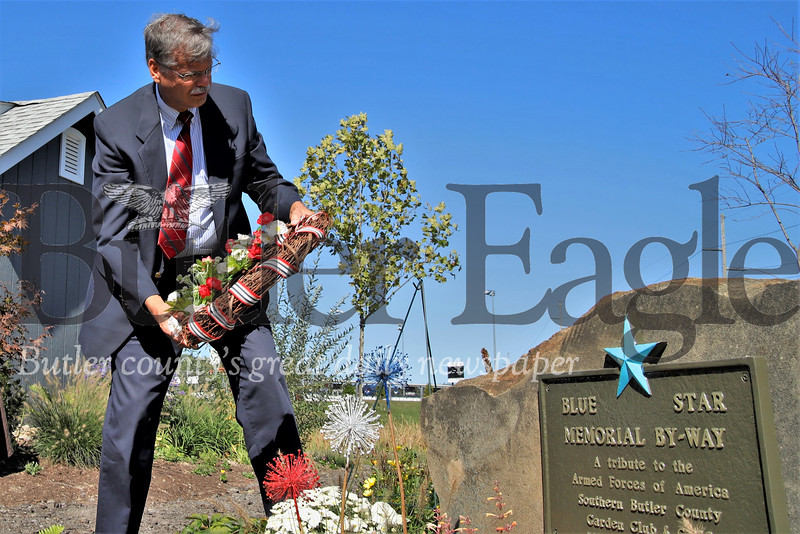 Retired navy lieutenant Bill Mack lays a Wreath at the new Blue Star memorial during a dedication ceremony at Cranberry's Graham Park Wednesday. Seb Foltz/Butler Eagle