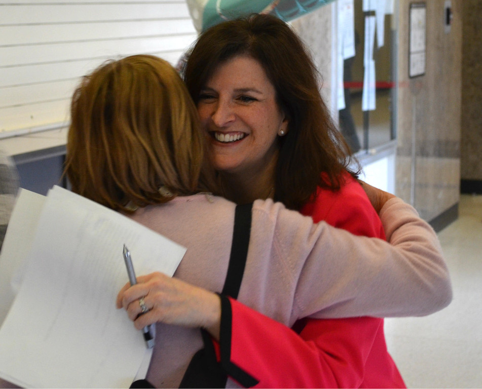 ". Oakland County Clerk Lisa Brown hugs Oakland County Commissioner Marcia Gershenson, a Bloomfield Hills Democrat, at the county courthouse Saturday morning. ""Good morning! How\'s everyone doing today?\"" Brown said to cheers from those waiting in line for a marriage license. Dustin Blitchok-The Oakland Press"