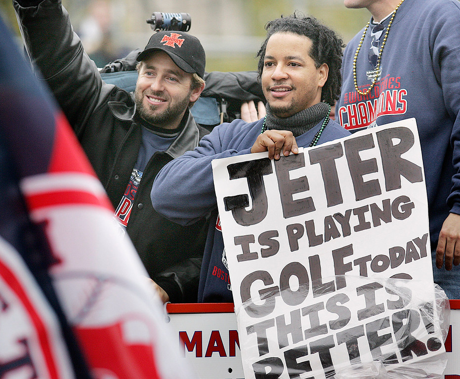 . Boston Red Sox\'s Kevin Millar, left, and Manny Ramirez, right, react to the crowd during the Red Sox World Series Championship parade through the streets of Boston, Saturday, Oct. 30, 2004. (AP Photo/Michael Dwyer)