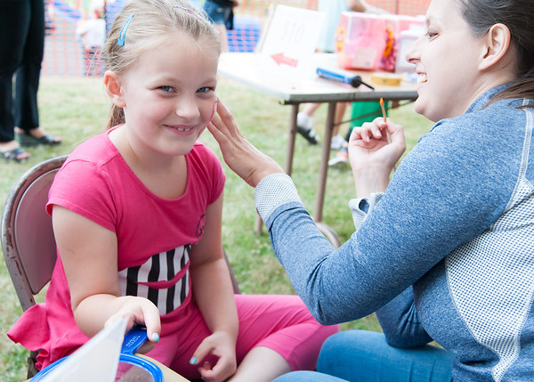 06/21/18 Wesley Bunnell | Staff Krystan Nadeau, age 6, has a butterfly painted on her face by Michelle Szylobryt on the first night of the Sacred Heart Parish Festival on Friday evening.