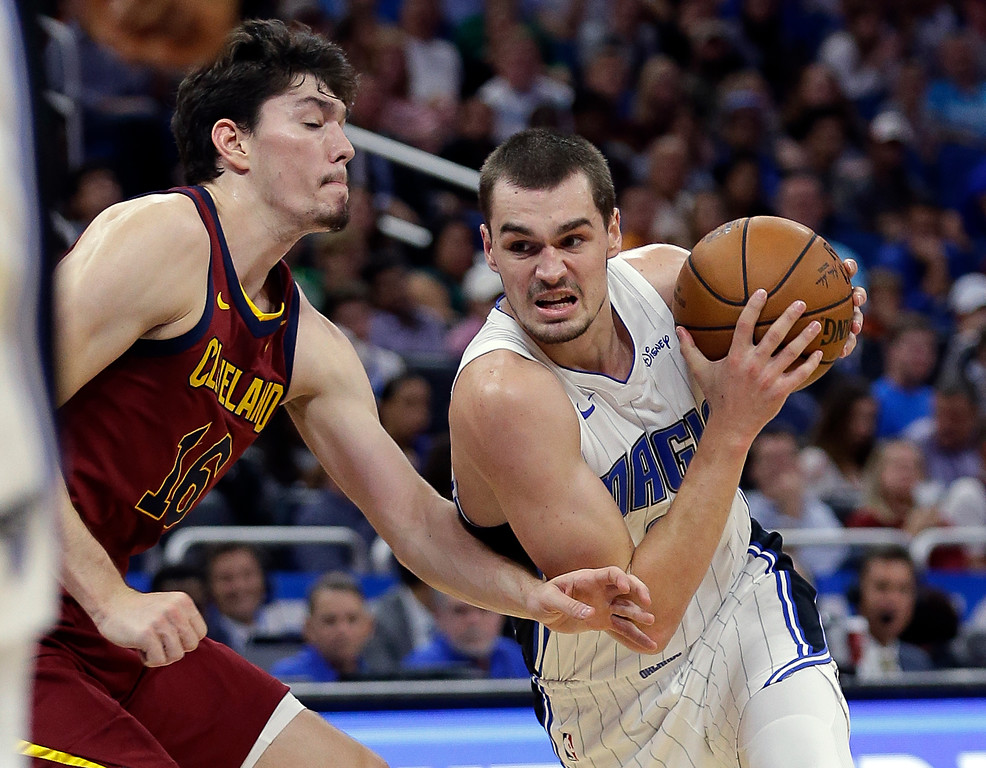 . Orlando Magic\'s Mario Hezonja, right, drives around Cleveland Cavaliers\' Cedi Osman during the second half of an NBA preseason basketball game, Friday, Oct. 13, 2017, in Orlando, Fla. Cleveland won 113-106. (AP Photo/John Raoux)