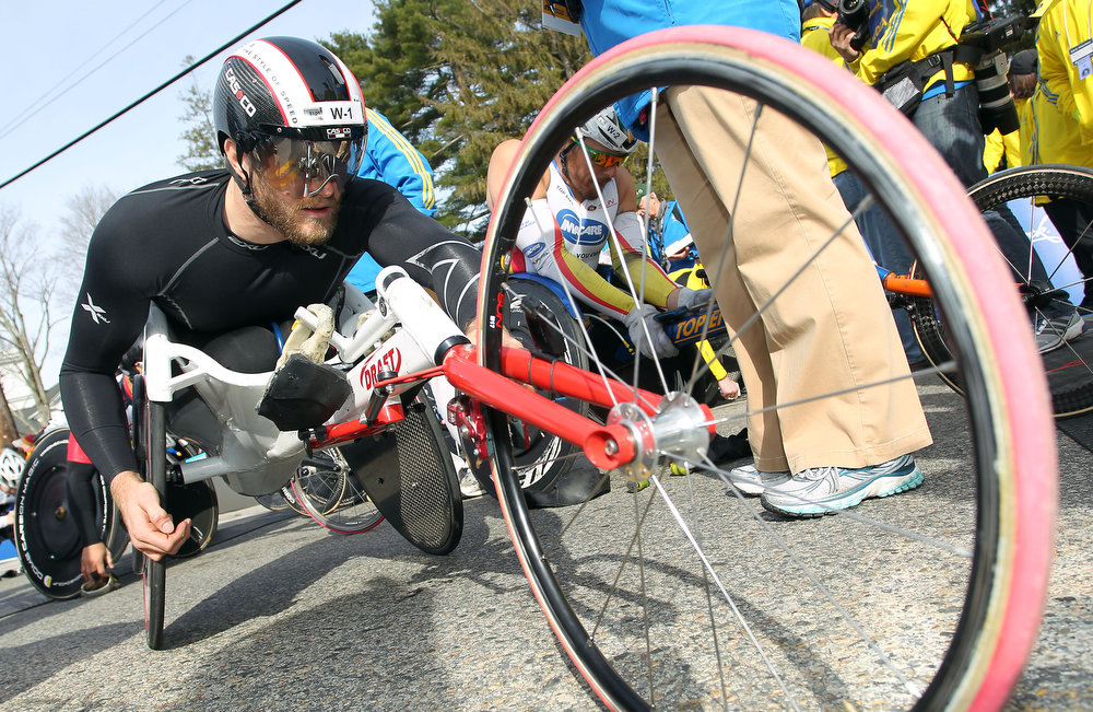 . Defending champion Josh Cassidy, of Canada, adjusts his wheelchair prior to the wheelchair division start of the 117th running of the Boston Marathon, in Hopkinton, Mass., Monday, April 15, 2013. (AP Photo/Stew Milne)