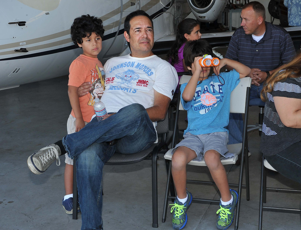 . 8/21/13 - L-R Quevedo family Lucas, 5, Ralph, and Noah, 7, wait their turn to go flying on Wednesday afternoon. Pediatric rehabilitation patients from Miller Children�s Hospital Long Beach got experience their first �Discovery Flight� at the California Flight Center. After some training from the pilots the kids got to actually pilot the plane on their own. The program which uses volunteer pilots has taken 125 kids in the air. Photo by Brittany Murray, Press Telegram