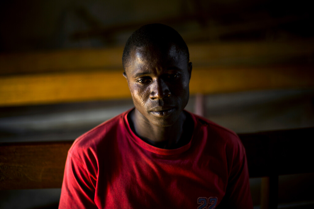 . In this photo taken Thursday Nov. 20, 2014, Etienne Ouamouno sits in the communal room in the Guinean village of Meliandou, some 400 miles (600 kms) south-east of Conakry, Guinea. Etienne\'s son, Emile is widely recognized by researchers as Patient Zero, the first person to have died of Ebola back on December 28 last year.  (AP Photo/Jerome Delay)
