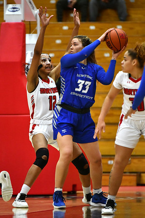 12/21/2019 Mike Orazzi | StaffrThe University of Hartford's Lawrencia Moten (12) and CCSU's Ashley Berube (33) during Saturday's women's basketball game in West Hartford. r