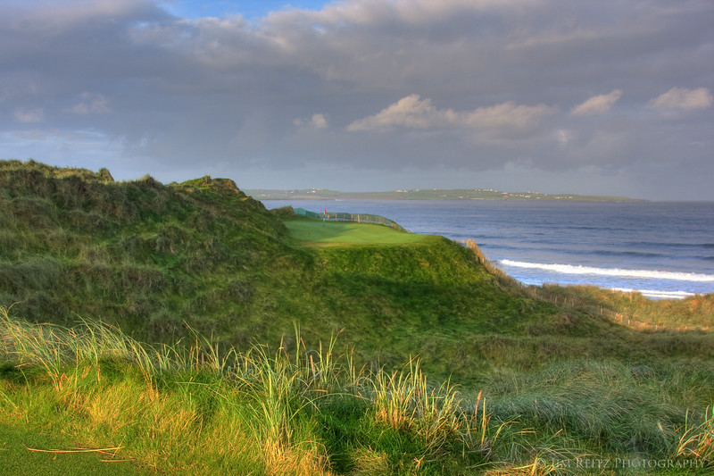 14th hole at Doonbeg - a tiny par 3 green on the sde of a dune.